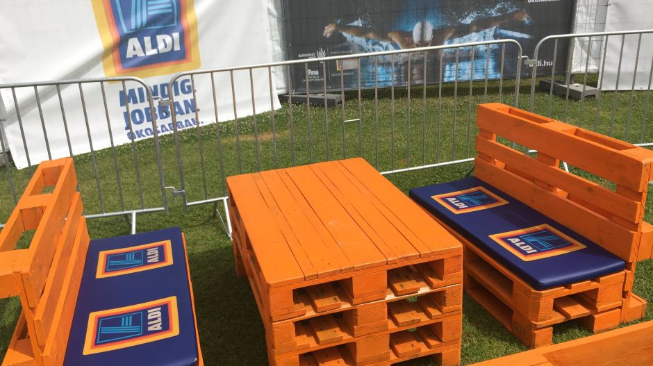 The leisure zone around the store was made up of brightly painted euro pallets with Aldi-branded seat cushions.