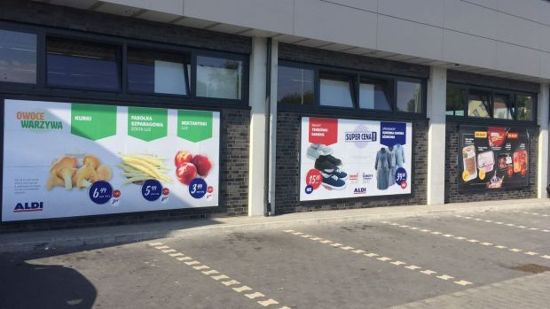 Aldi shops' exterior walls are now also covered in promotional billboards, similar to Lidl's approach.